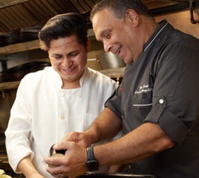 Carmine's executive chef laughing with line cook